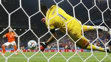 Argentina's Sergio Romero (front) saves the penalty of Ron Vlaar of the Netherlands during their shootout in their 2014 World Cup semi-finals at the Corinthians arena in Sao Paulo July 9, 2014. (Reuters)