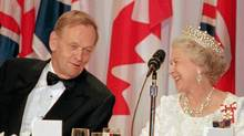 Queen Elizabeth and Prime Minister Jean Chretien smile at the beginning of an official dinner in St. John's Newfoundland in this file photo dated June 1997. Queen Elizabeth has appointed Jean Chretien to the exclusive Order of Merit. The honour is restricted to 24 living members and few foreigners. (Jacques Boissinot/The Canadian Press/Jacques Boissinot/The Canadian Press)