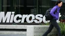 A person walks past a Microsoft sign on January 22, 2009 in Redmond, Washington. (Robert Giroux/Robert Giroux/Getty Images)