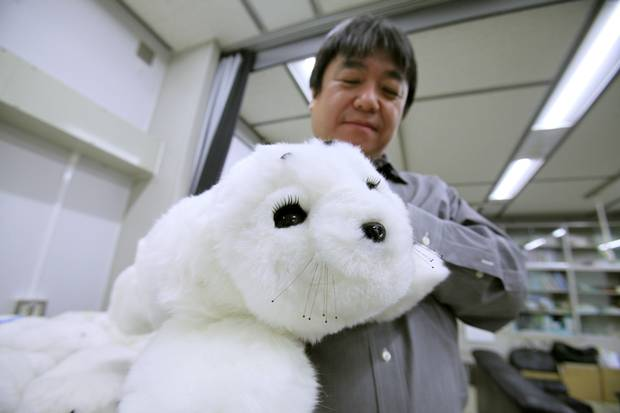 Takanori Shibata and his Paro robotic seal. (Iain Marlow/The Globe and Mail)
