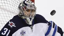 The Winnipeg Jets and goaltender Ondrej Pavelec will open the first of their five game season series against Central Division rival Minnesota Wild on Thursday in St. Paul, Minn. (file photo) (BEN NELMS/REUTERS)