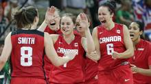 Canada's Kim Smith (8) is congratulated by Shona Thorburn, right, Courtnay Pilypaitis, center, and teammates after beating Brazil in a women's basketball game at the 2012 Summer Olympics, Friday, Aug. 3, 2012, in London. Canada beat Brazil. (Charles Krupa/AP)