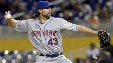 New York Mets' R.A. Dickey pitches to the Miami Marlins during the first inning of a baseball game in Miami, Tuesday, Oct. 2, 2012. (Associated Press)