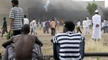 Sudanese demonstrators destroy the U.S. embassy in Khartoum September 14, 2012. At least one protester was killed on Friday during a demonstration against an anti-Islam film outside the U.S. embassy in Sudan, a doctor said. (MOHAMED NURELDIN ABDALLAH/REUTERS)