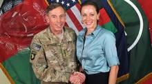 "This July 13, 2011, photo made available on the International Security Assistance Force's Flickr website shows the former Commander of International Security Assistance Force and U.S. Forces-Afghanistan Gen. David Petraeus, left, shaking hands with Paula Broadwell, co-author of his biography ""All In: The Education of General David Petraeus."" (AP)"