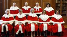 Canada's Supreme Court Justices pose for a photo at the Supreme Court of Canada in Ottawa November 14, 2011. The Justices are (bottom row L - R) Morris Fish, Louis LeBel, Chief Justice Beverley McLachlin, Marie Deschamps, Rosalie Abella; (top row L - R) Michael Moldaver, Marshall Rothstein, Thomas Cromwell and Andromache Karakatsanis. (BLAIR GABLE/REUTERS/Blair Gable)
