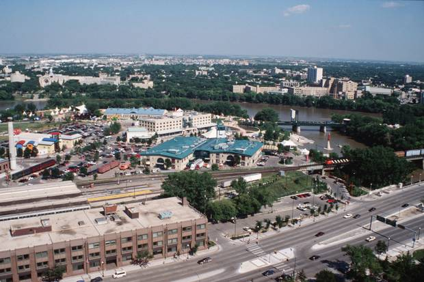 Businesses and parkland at the Forks, shown soon after redevelopment, are now major downtown attractions in downtown Winnipeg.