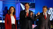 Republican presidential candidates Michele Bachmann, Mitt Romney and Rick Perry are introduced at a presidential debate in Tampa, Fla., on Tuesday. (Joe Readle/Getty Images)