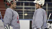 Team Canada goalies James Reimer, left, and Ben Scrivens chat during practice at the IIHF Ice Hockey World Championship in Minsk Belarus on Wednesday, May 21, 2014. (Jacques Boissinot/THE CANADIAN PRESS)