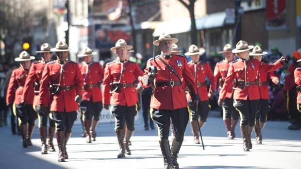 Members of the RCMP make their way along Ste. Catherine street during the 190th consecutive annual St. Patrick's Day parade in Montreal, Sunday, March 17, 2013. (Graham Hughes/THE CANADIAN PRESS)