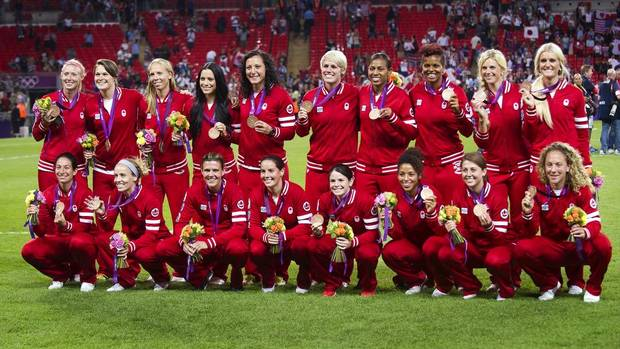 Canada's women's soccer team poses for a team photo after being presented with their bronze medal at the 2012 Summer Olympics in Coventry, England, Thursday August 9/2012.