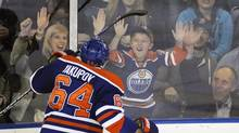Edmonton Oilers' Nail Yakupov celebrates his second of three goals against the Vancouver Canucks with the fans during the third period of their NHL game in Edmonton April 27, 2013. (DAN RIEDLHUBER/REUTERS)