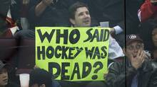 A fan holds up a sign as Team WHL and Team Russia play during the third period in game 5 of the CHL Subway Super Series in Vancouver, B.C., on Wednesday November 14, 2012 (The Canadian Press)