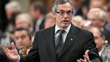 Treasury Board President Tony Clement speaks during Question Period in the House of Commons on June 7, 2011. (CHRIS WATTIE/REUTERS)