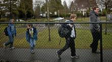 Eric Jamieson arrives with his three sons at the Shaughnessy Point Grey Out of School Care Society located at Quilchena Elementary school in Vancouver, British Columbia, Monday, March 5, 2012. (Rafal Gerszak for The Globe and Mail/Rafal Gerszak for The Globe and Mail)