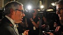 Treasury Board President Tony Clement speaks to reporters in the foyer of the House of Commons on Sept. 19, 2011. (Sean Kilpatrick/THE CANADIAN PRESS)