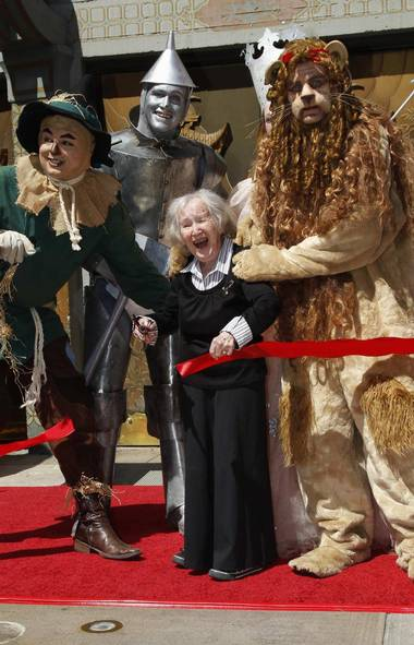 Ready to trip down the Yellow Brick Road? One of the last living Munchkins, Ruth Ducccini. 95, fends off the advances of the Cowardly Lion at the premiere of 'The Wizard of Oz 3D' in Los Angeles. (FRED PROUSER/REUTERS)