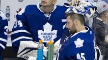 Jonathan Bernier and James Reimer during a break in the third period of the Leafs season opener against the Ottawa Senators at the ACC in Toronto on Oct. 5, 2013. (PETER POWER/THE GLOBE AND MAIL)