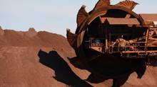 A bucket wheel reclaimer is moved into position at BHP Billiton's iron ore loading facility in Port Hedland, Australia. (TIM WIMBORNE/Reuters)