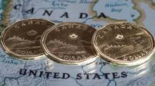 Demand for Canadian dollars is coming mainly from emerging economies, not advanced economies, who still prefer the traditional reserve currencies – the U.S. dollar, euro, Japanese yen, British pound and Swiss franc. (Paul Chiasson/THE CANADIAN PRESS)