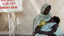 A displaced Sudanese woman waits for a medical checkup with her baby in front of an emergency service at the Turkish Red Crescent Hospital in the city of Nyala, the capital of South Darfur state in the western part of the Sudan, 03 August 2007. (MUSTAFA OZER/AFP/Getty Images/MUSTAFA OZER/AFP/Getty Images)