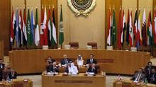 Arab League delegates meet in Cairo on Wednesday to discuss Syria, which accepted the league's peace plan that would withdraw security forces from the streets and begin talks between the government and opposition. (Mohamed Abd-El-Ghany/Reuters)