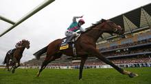 Tom Quealy on Frankel races ahead of Olivier Peslier on Cirrus des Aigles to win The Champion Stakes during the British Champions Day at Ascot racecourse in England on Saturday. (EDDIE KEOGH/REUTERS)