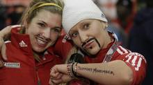 Canda's pilot Kaillie Humphries, right, and brakeman Chelsea Valios celebrate after winning the women's two-man bobsled World Cup competition on Friday, Nov. 16, 2012, in Park City, Utah. (Rick Bowmer/AP)