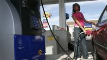 File photo of a customer at a Sunoco gas stations. (Arantxa Cedillo/The Globe and Mail)