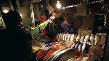 China said Thursday that overall inflation dipped to 4.1 per cent in December, the fifth consecutive month of decline. But food prices spiked to 9.1 per cent, up from November's 8.8 per cent. (David Gray/Reuters/David Gray/Reuters)