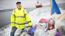 Chaplain Nick Parker delivers gifts to crew members aboard ships anchored in Vancouver's outer harbour on Christmas Eve. (John Lehmann/The Globe and Mail)