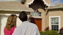 Couple buying a home (James Kurtz/Getty Images/iStockphoto)