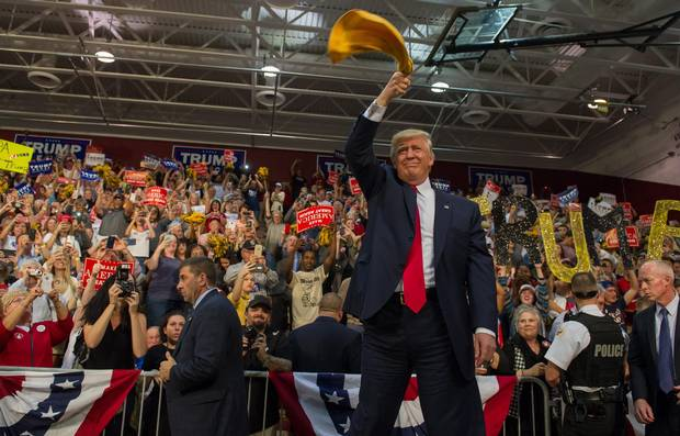 Donald Trump waves a Terrible Towel to supporters at a rally on Oct. 10 in Ambridge, Pennsylvania. Ambridge is named after the American Bridge Company, a steel fabricating plant that employed 60,000 workers. The former industrial community is a traditionally Democratic stronghold that is shifting Republican.