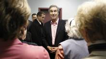 Liberal Leader Michael Ignatieff speaks with volunteers at a Quebec City community centre on April 5, 2011. (Mathieu Belanger/Reuters/Mathieu Belanger/Reuters)