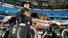 Cam McQueen with the first Canadian monster truck - a red-and-black behemoth named Northern Nightmare. (MICHELLE PRATA/Michelle Prata/CP Photo)