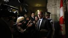 Claude Carignan, the Government Leader in the Senate, speaks to journalists on Parliament Hill on Oct. 30, 2013. (CHRIS WATTIE/REUTERS)