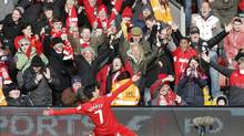 Liverpool's Luis Suarez celebrates scoring against Tottenham Hotspur during their English Premier League soccer match at Anfield in Liverpool, northern England, March 10, 2013. (PHIL NOBLE/REUTERS)