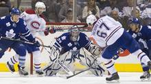 Montreal Canadiens' Max Pacioretty (R) scores on Toronto Maple Leafs' goalie James Reimer in the second period of their NHL hockey game in Toronto February 11, 2012. (Reuters)