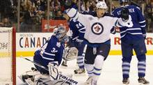 Toronto Maple Leafs goaltender James Reimer and defenceman Mike Komisarek (right) react as Winnipeg Jets left winger Brett MacLean (25) celebrates a goal by teammate Tobias Enstrom, not shown, during first period NHL action in Toronto on Wednesday October 19, 2011. MacLean was in the prime of his life. Just 23 years old and coming off a 25-goal season in the American Hockey League, he had his eye on a permanent spot in the NHL when he suited up for a pick-up game in July. That dream was wiped away in an instant. (Frank Gunn/THE CANADIAN PRESS)