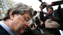 File photo of Garth Drabinsky leaving the court house amongst a sea of journalists. (Charla Jones/The Globe and Mail)