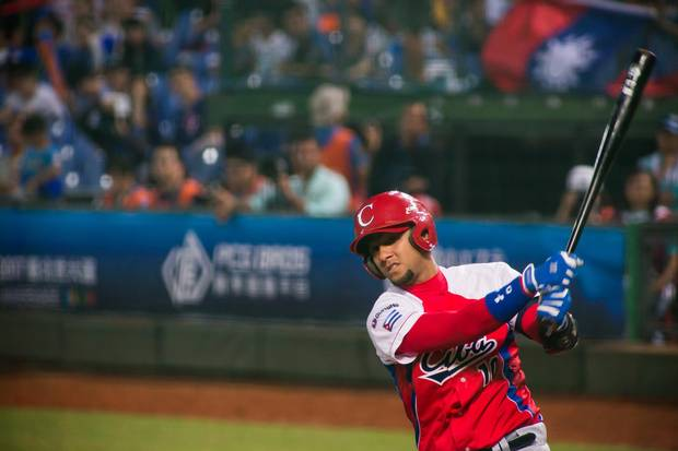 YULIESKI GURRIEL #10 of Cuba plays the WBSC Premier 12 match between Cuba and Taiwan at the Taichung Intercontinental Baseball Stadium on November 14, 2015 in Taichung, Taiwan.