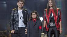"FILE - In this Oct. 8, 2011 file photo, from left, Prince Jackson, Prince Michael II ""Blanket"" Jackson and Paris Jackson arrive on stage at the Michael Forever the Tribute Concert, at the Millennium Stadium in Cardiff, Wales. (Joel Ryan/AP)"