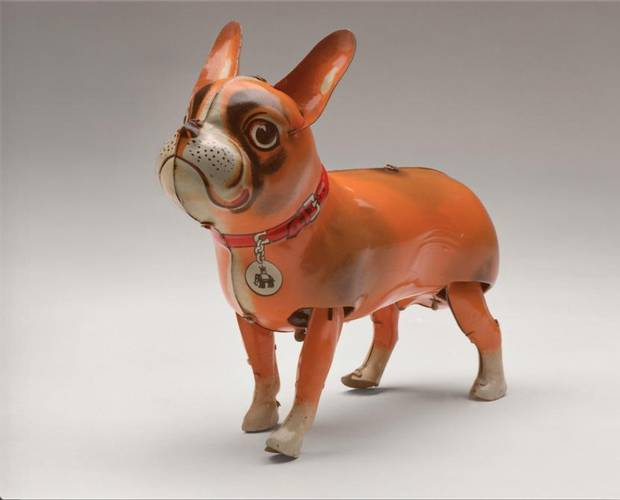"""A Blomer & Schuler clockwork tin toy of a French bulldog (c. 1950) with the company's """"Jumbo"""" logo on its collar tag."""
