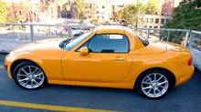 Chick cars really do exist, and the 2011 Mazda MX5 defines the genre - the orange MX5 looks like a rolling Smartie, so cute it hurts. (Peter Cheney/The Globe and Mail)