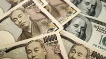 U.S. dollar smashes through 100-yen barrier (TRUTH LEEM/REUTERS)