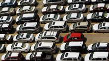 New vehicles sit in the lot in Boston in this file photo. (BRIAN SNYDER/REUTERS)