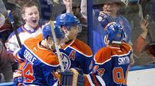 Edmonton Oilers Jordan Eberle (14), Taylor Hall (4) and Ryan Smyth (94) celebrate a goal against the Anaheim Ducks during second period NHL action in Edmonton, on Sunday April 6, 2014. (JASON FRANSON/THE CANADIAN PRESS)