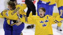 Sweden's Johan Sundstrom celebrates with teammates after defeating Russia in overtime in the gold medal game of the 2012 IIHF U20 World Junior Hockey Championships in Calgary. (Todd Korol/Reuters/Todd Korol/Reuters)