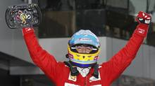 Fernando Alonso celebrates his win at the Malaysian Formula One Grand Prix in Sepang. (Mark Baker/AP)