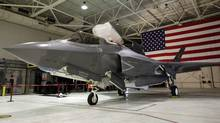 An F-35 Lightning II Joint Strike Fighter sits in a hangar at the U.S. Naval air station in Patuxent River, Md, on Jan. 20, 2012. (YURI GRIPAS/REUTERS)
